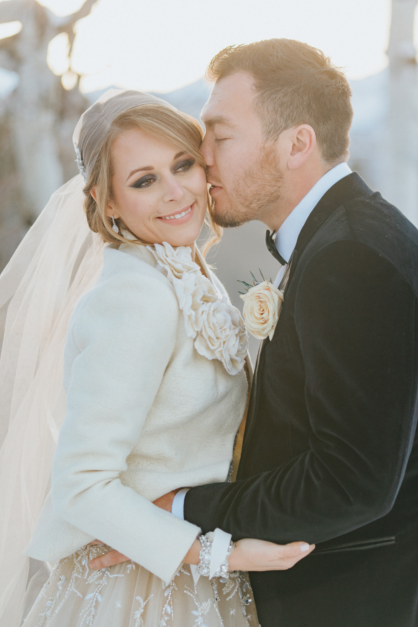 golden hour kiss bride wedding snow aspen