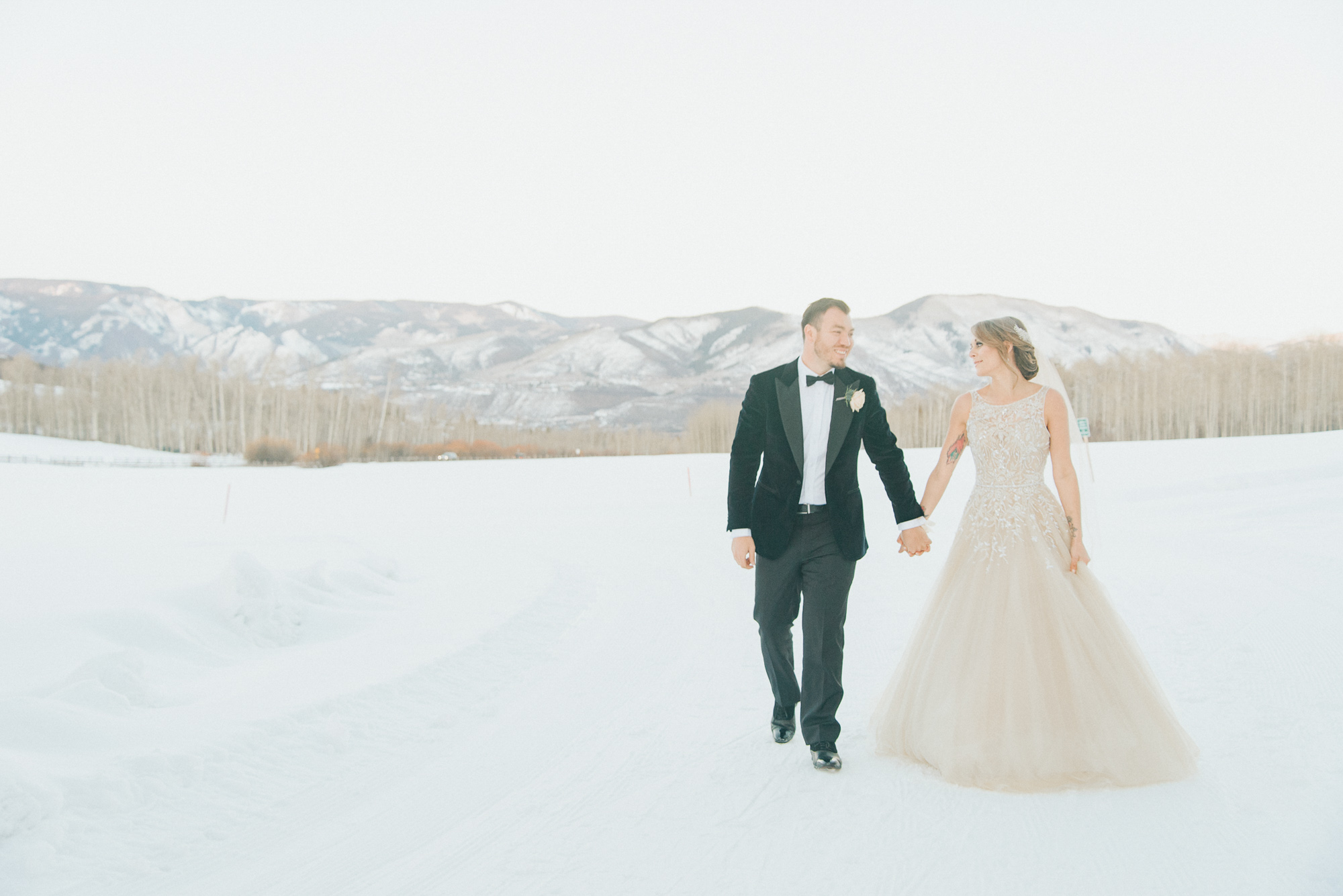 walking bride groom aspen snowmass mountain