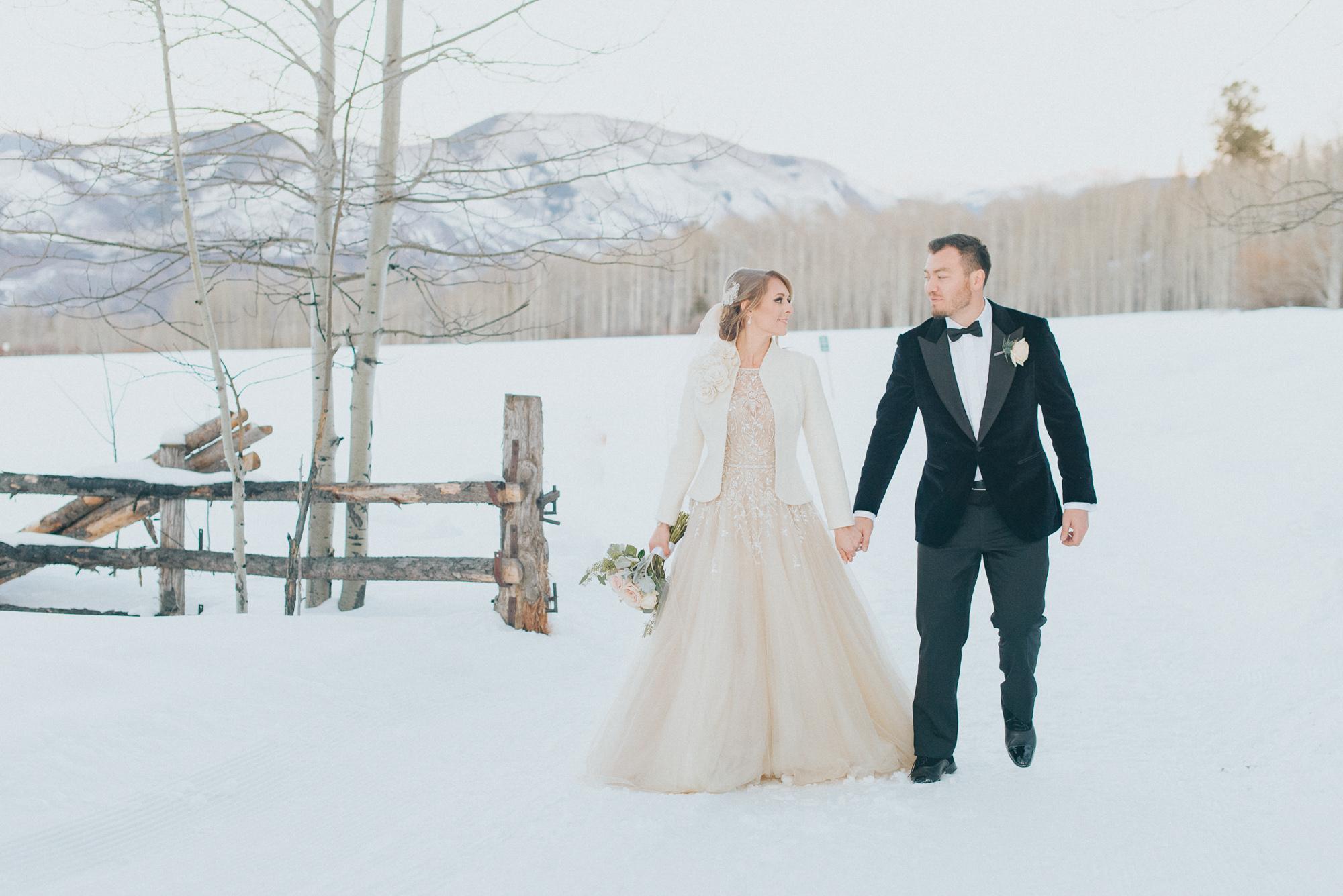 winter mountain wedding blush dress flowers snow