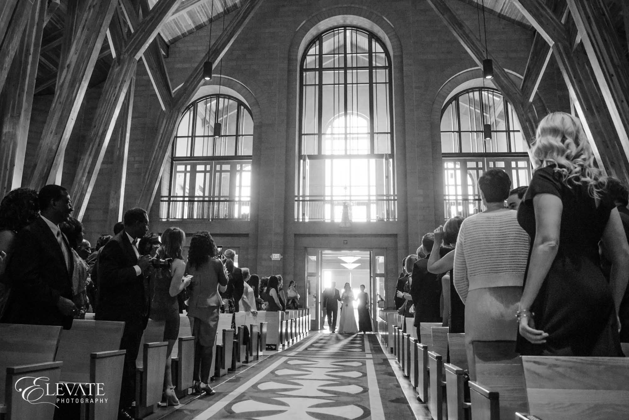 aurora wedding ceremony black and white stained glass