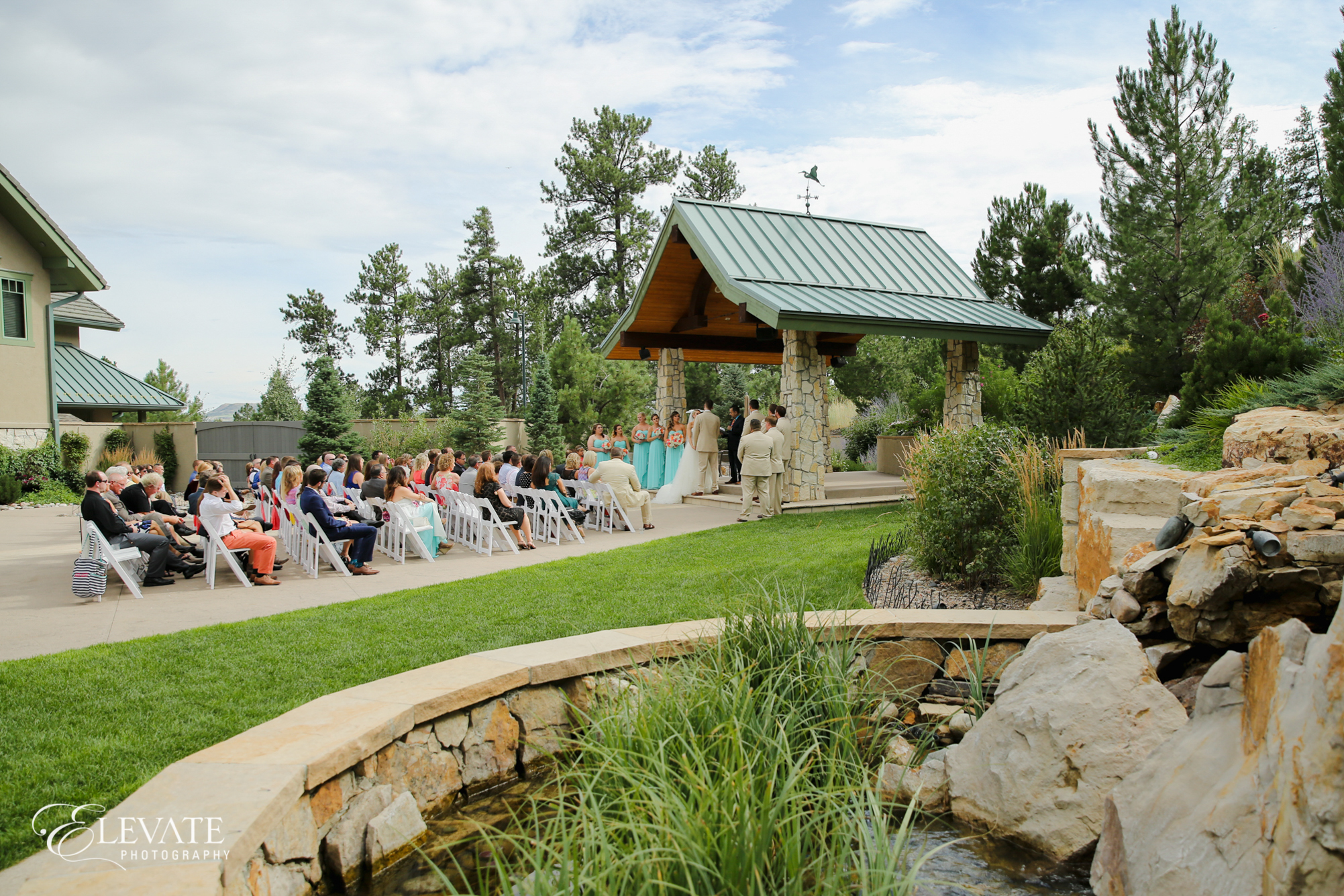 castle rock wedding ceremony outdoor summer by waterfall