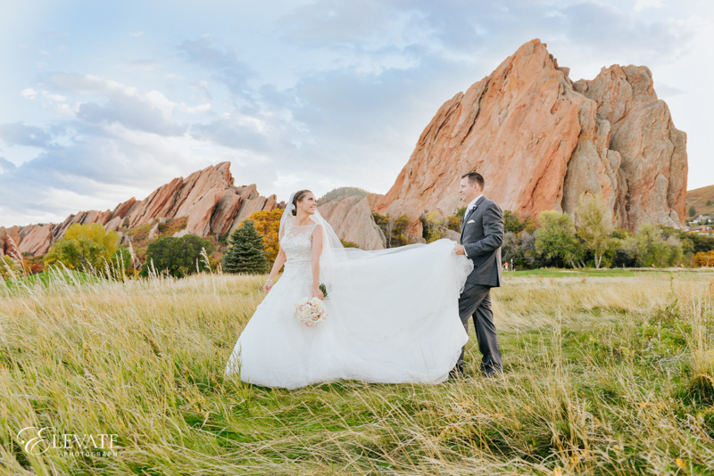 bride and groom in grasses