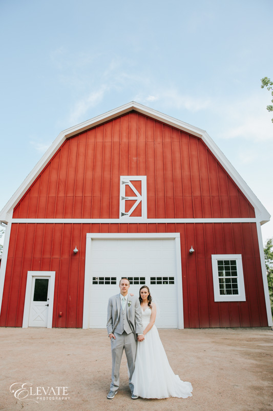 bride and groom portrait at barn