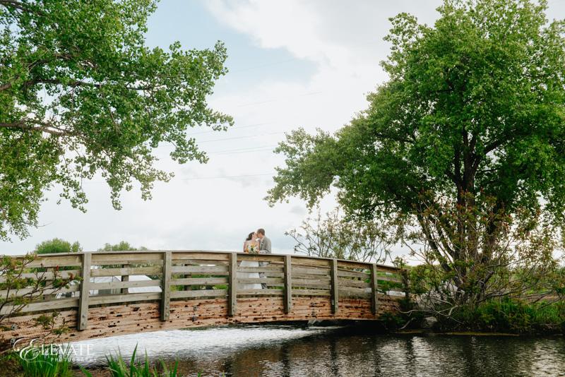 couple on bridge at Hudson Gardens