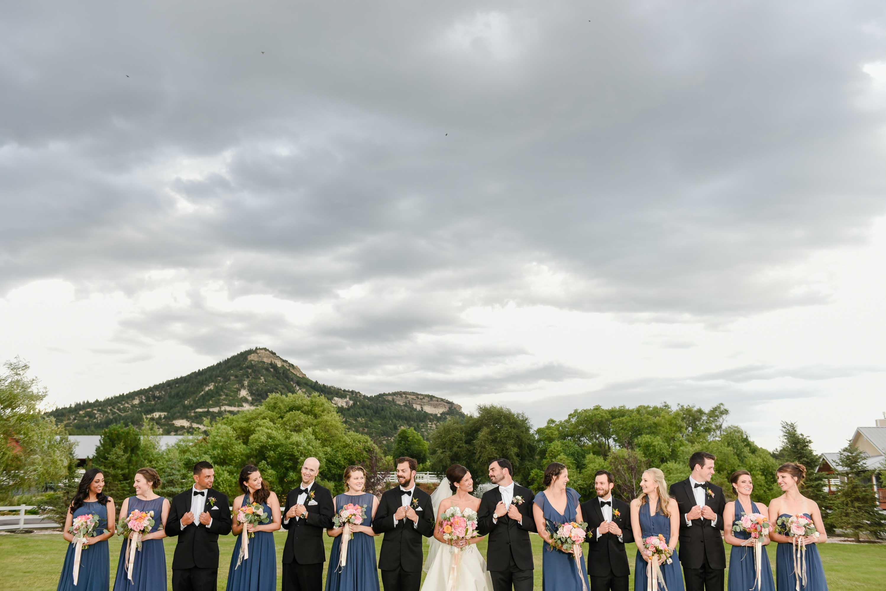 wedding party with mountains