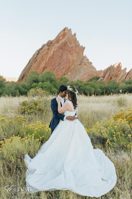 Wedding couple in fields of Arrowhead Golf Club