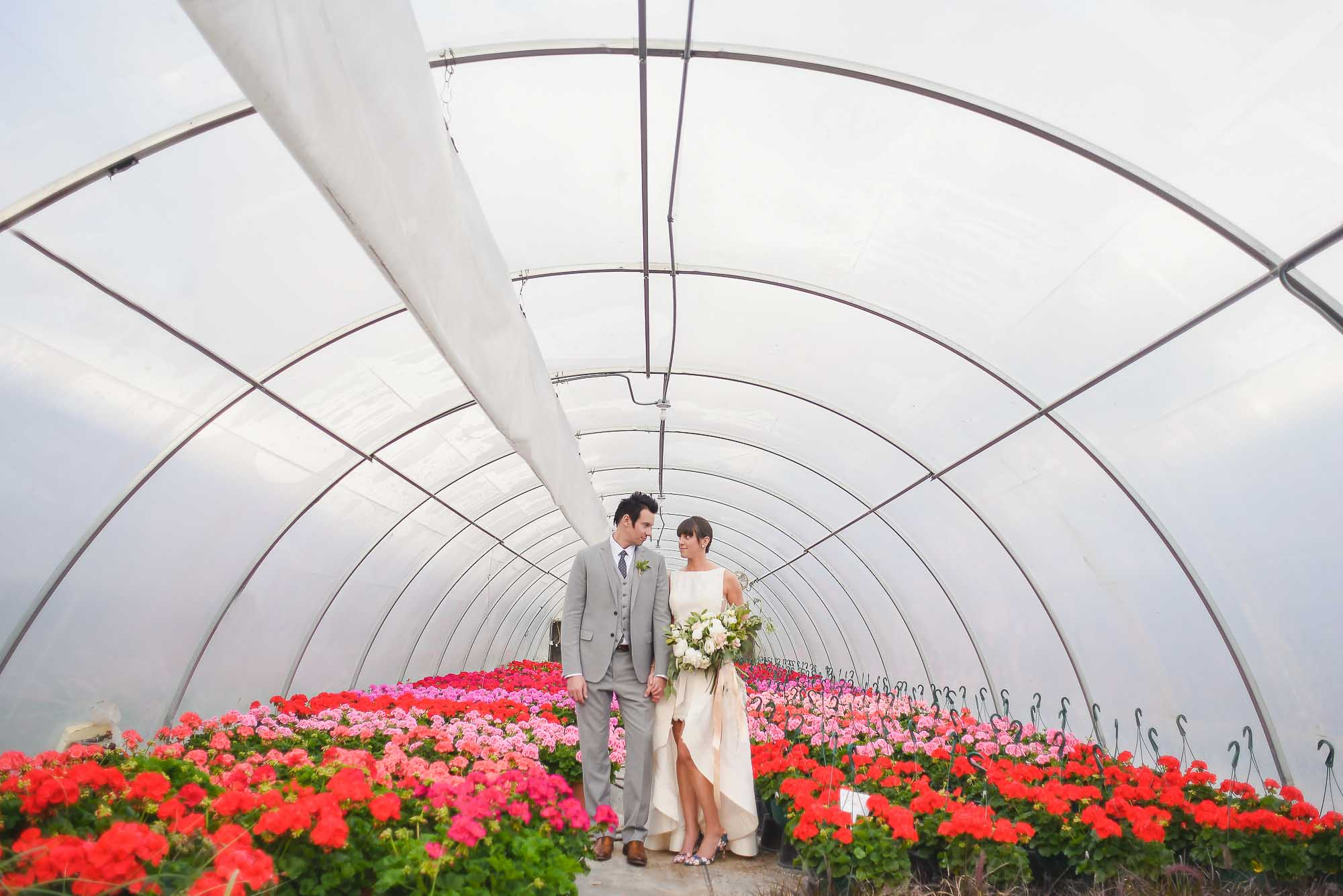 Bride and groom in greenhouse
