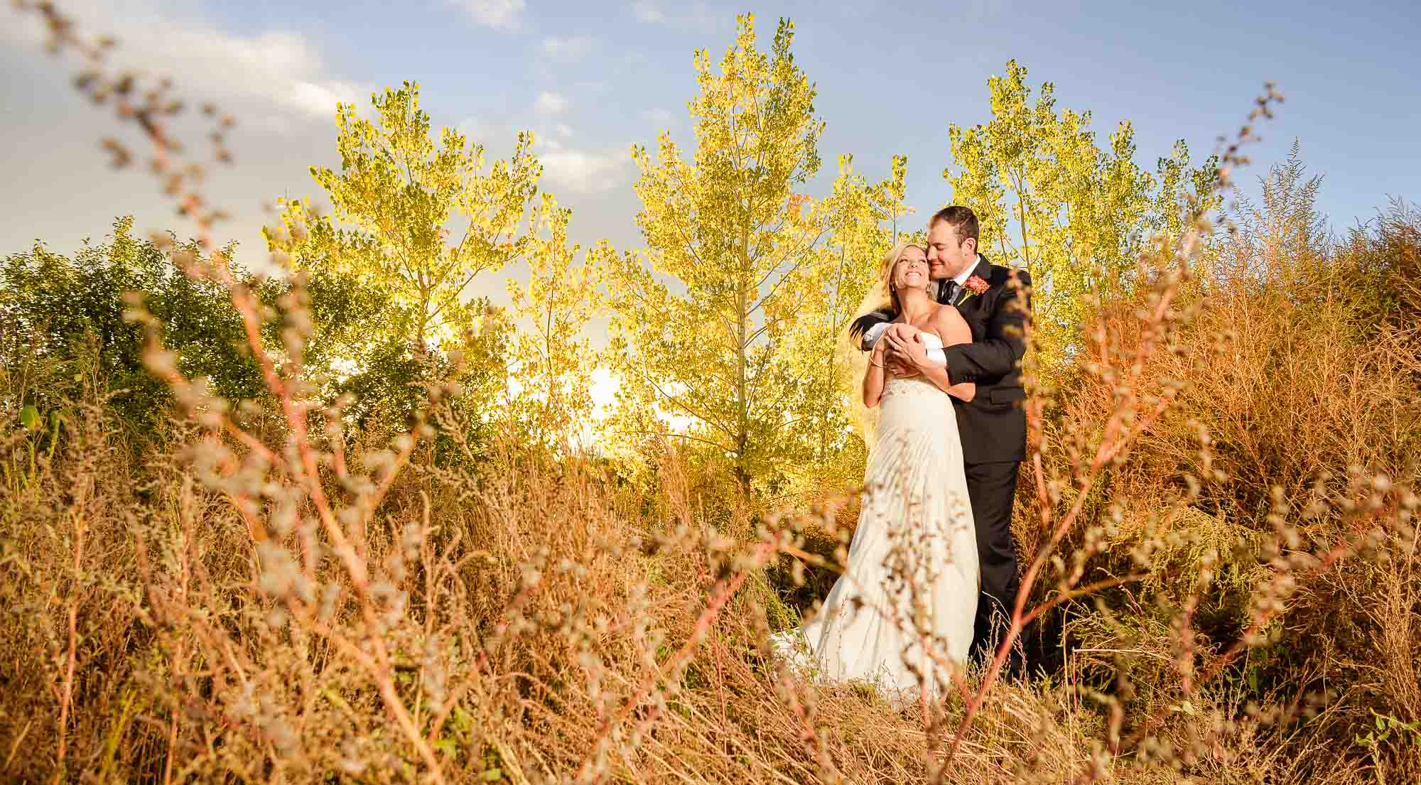 Fall with couple at Wellshire event center