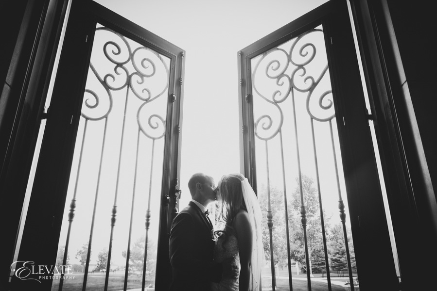 Bride and groom portrait at door
