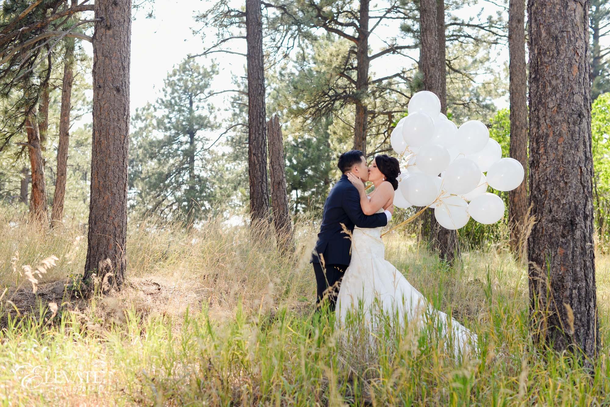 white balloon woods couple