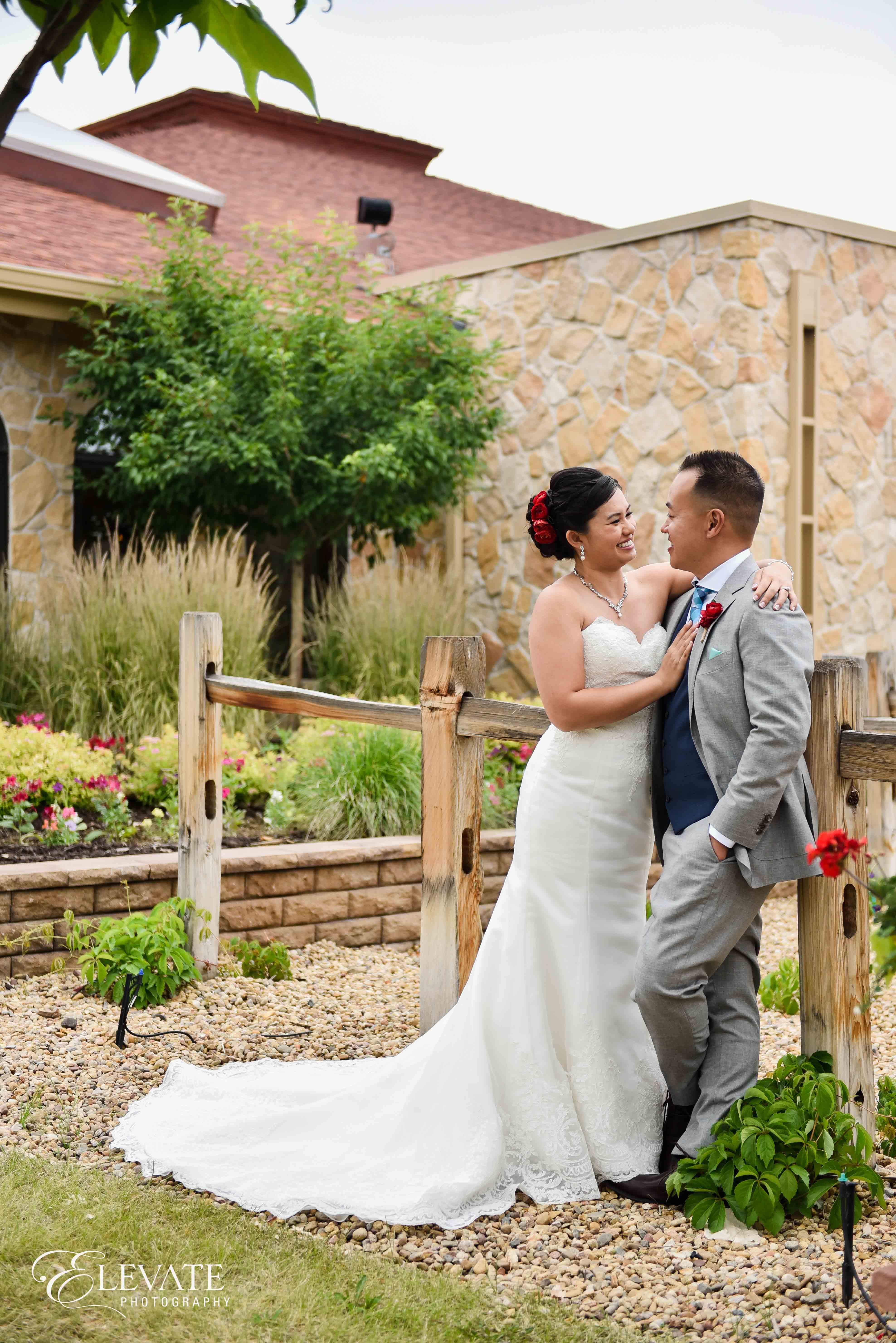 bride groom fence casual