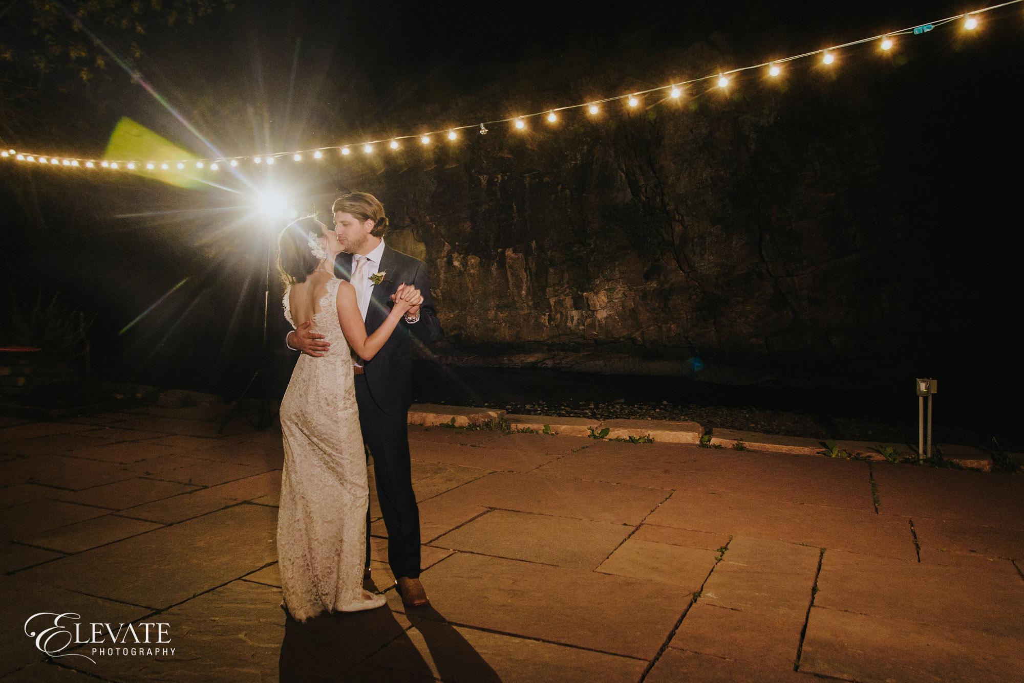 Outdoor wedding first dance market lights
