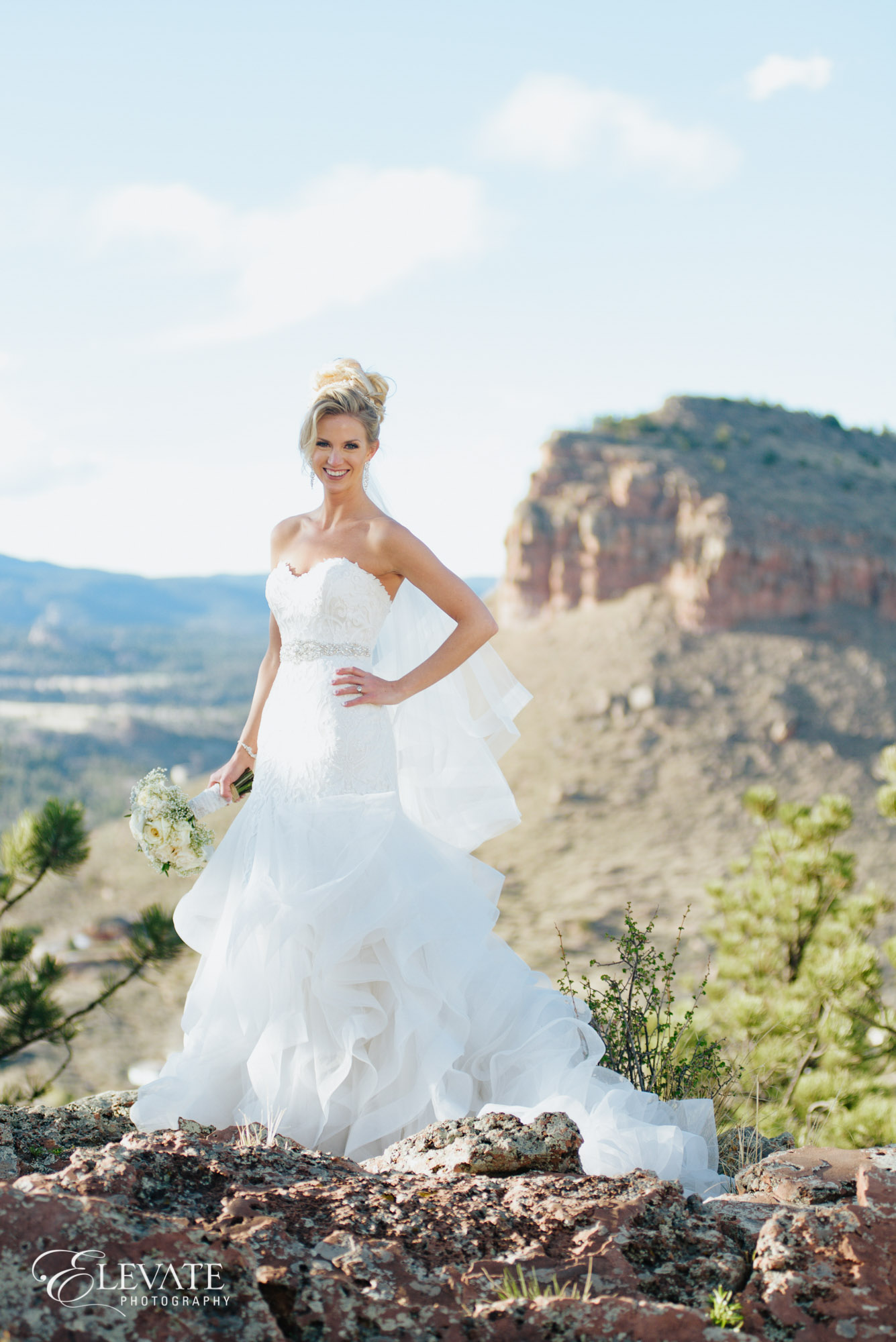 bride on top of mountain in Lyons