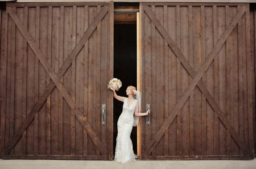 bride with flowers and doors