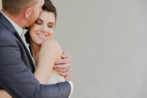 couple embrace smiling