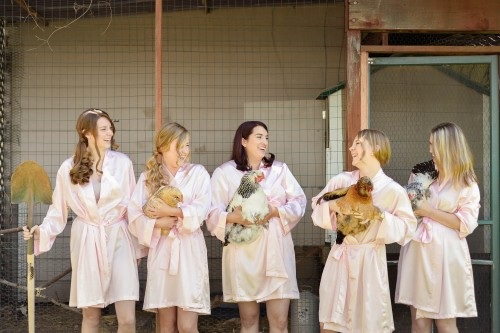 bridesmaids holding chickens in robes