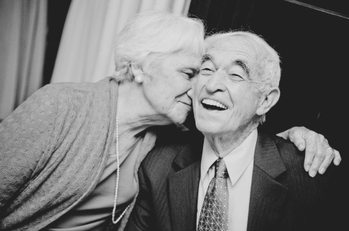 cute old couple kiss reception