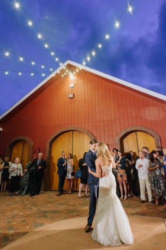 first dance outside barn market lights