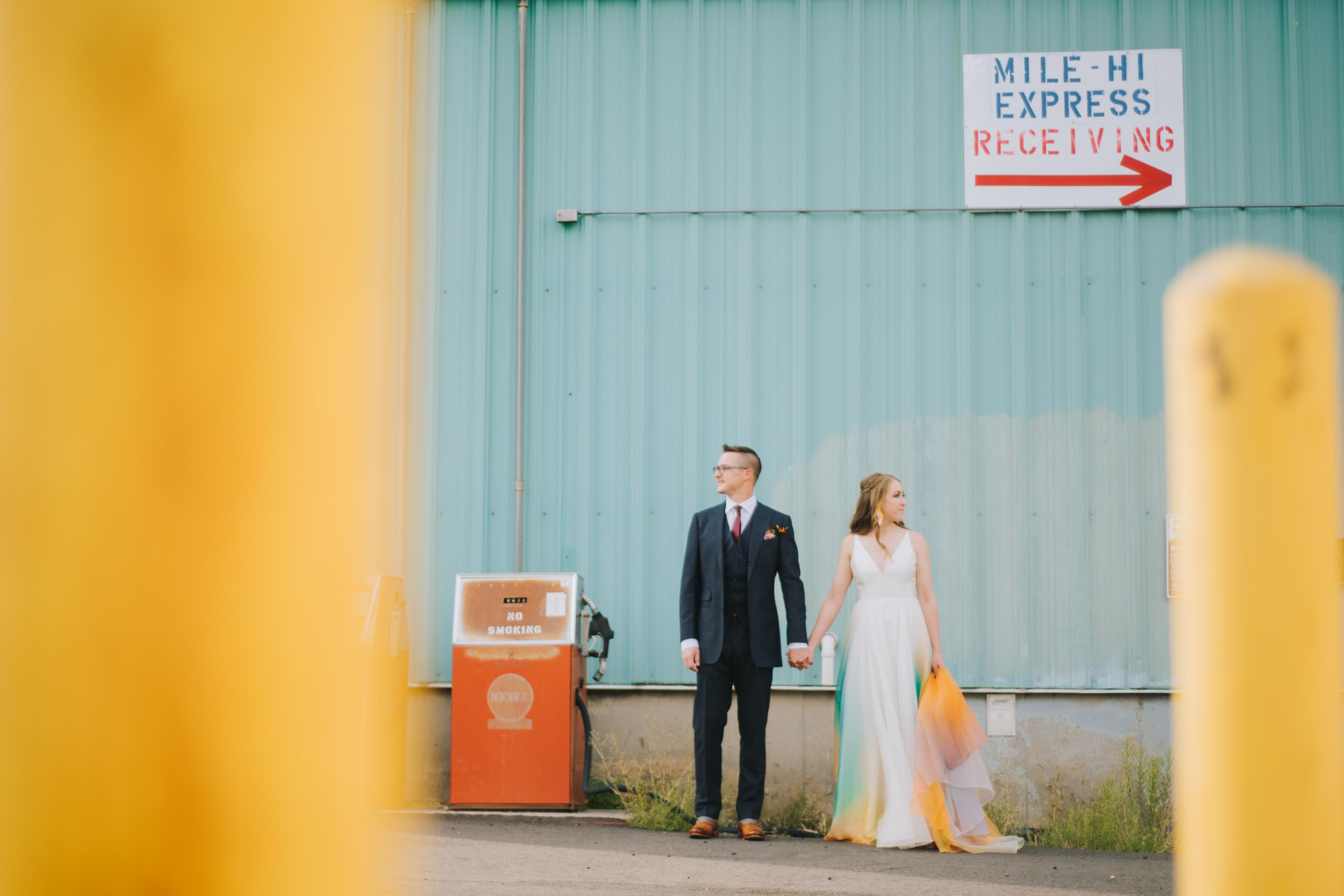 bride and groom with colorful surroundings