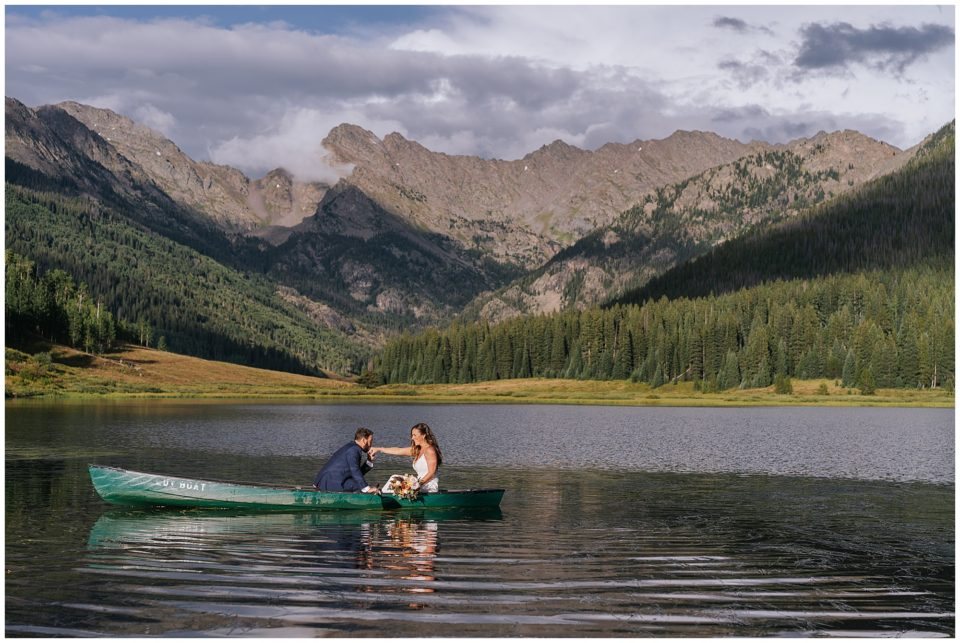 microwedding couple in canoe at piney river ranch photographed by Elevate Photography