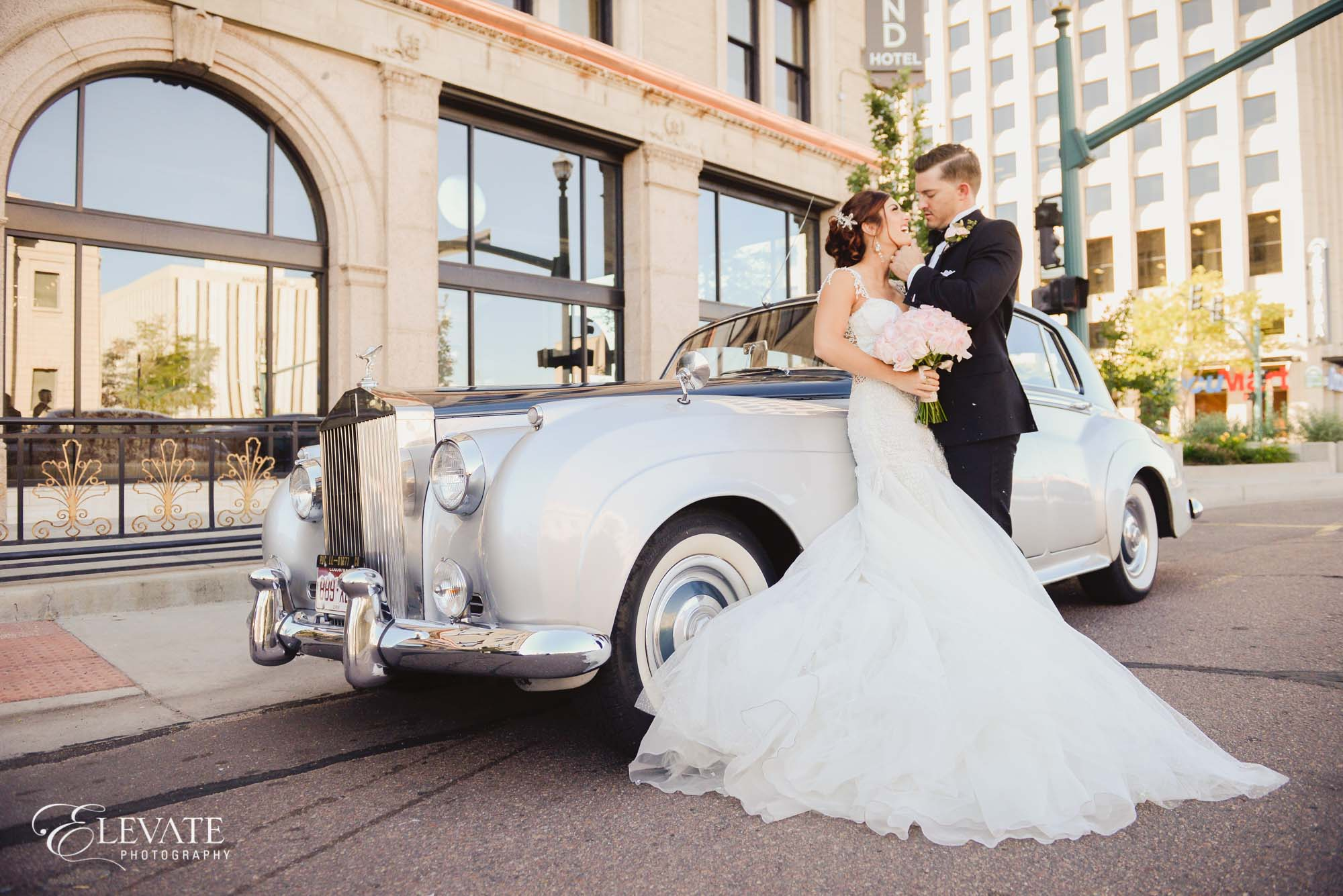 Bride and groom portrait classic car