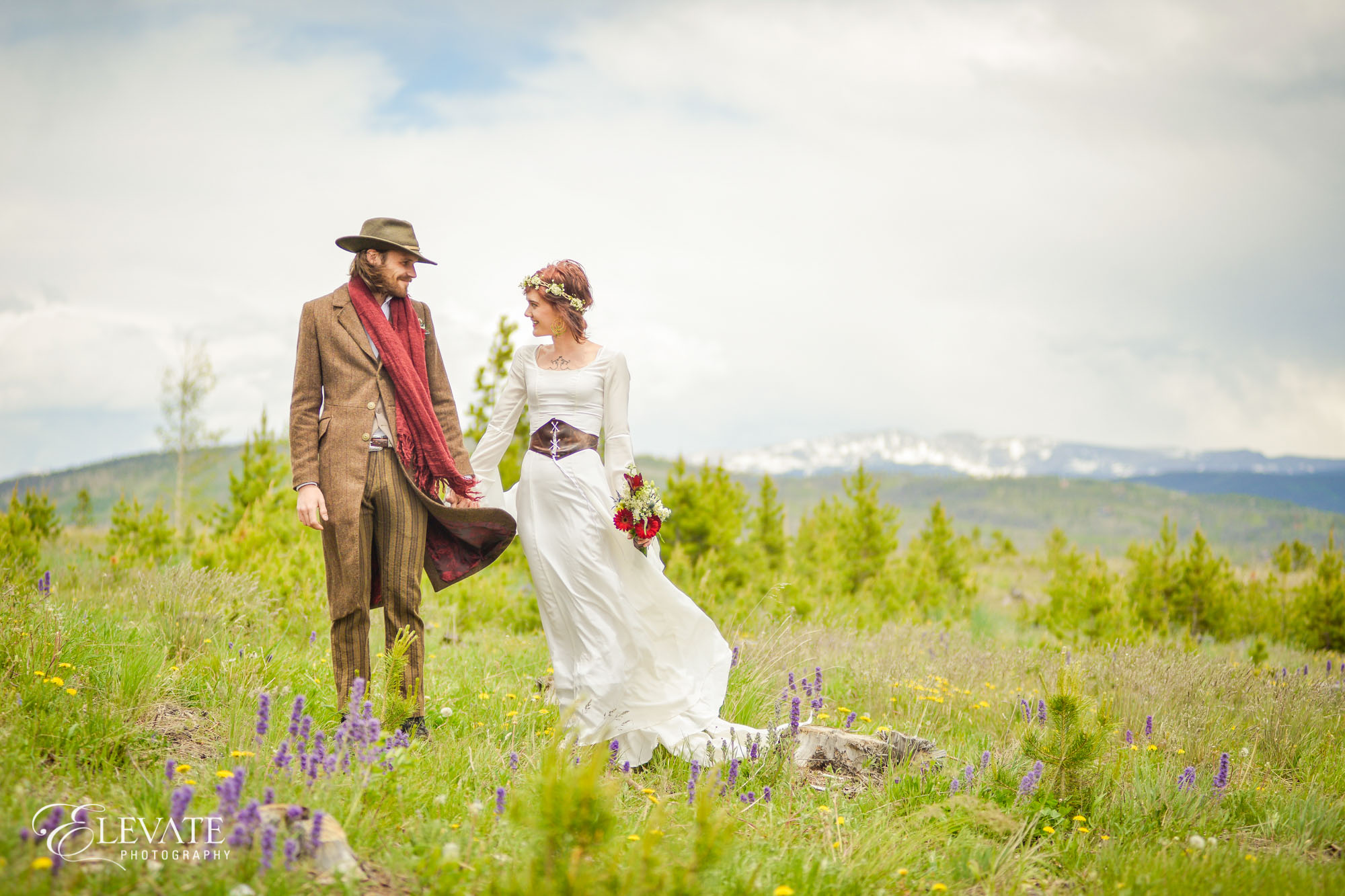 bride and groom in mountains