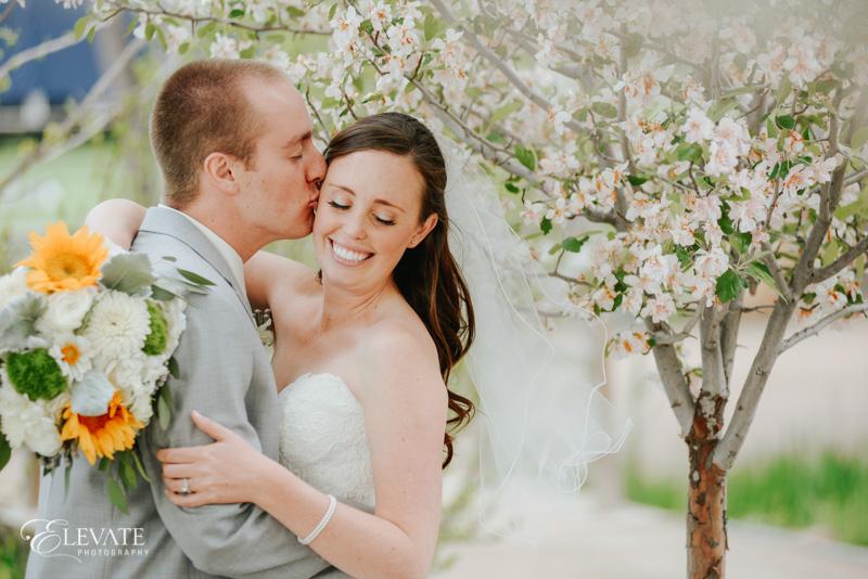 spring bride and groom with blossoms