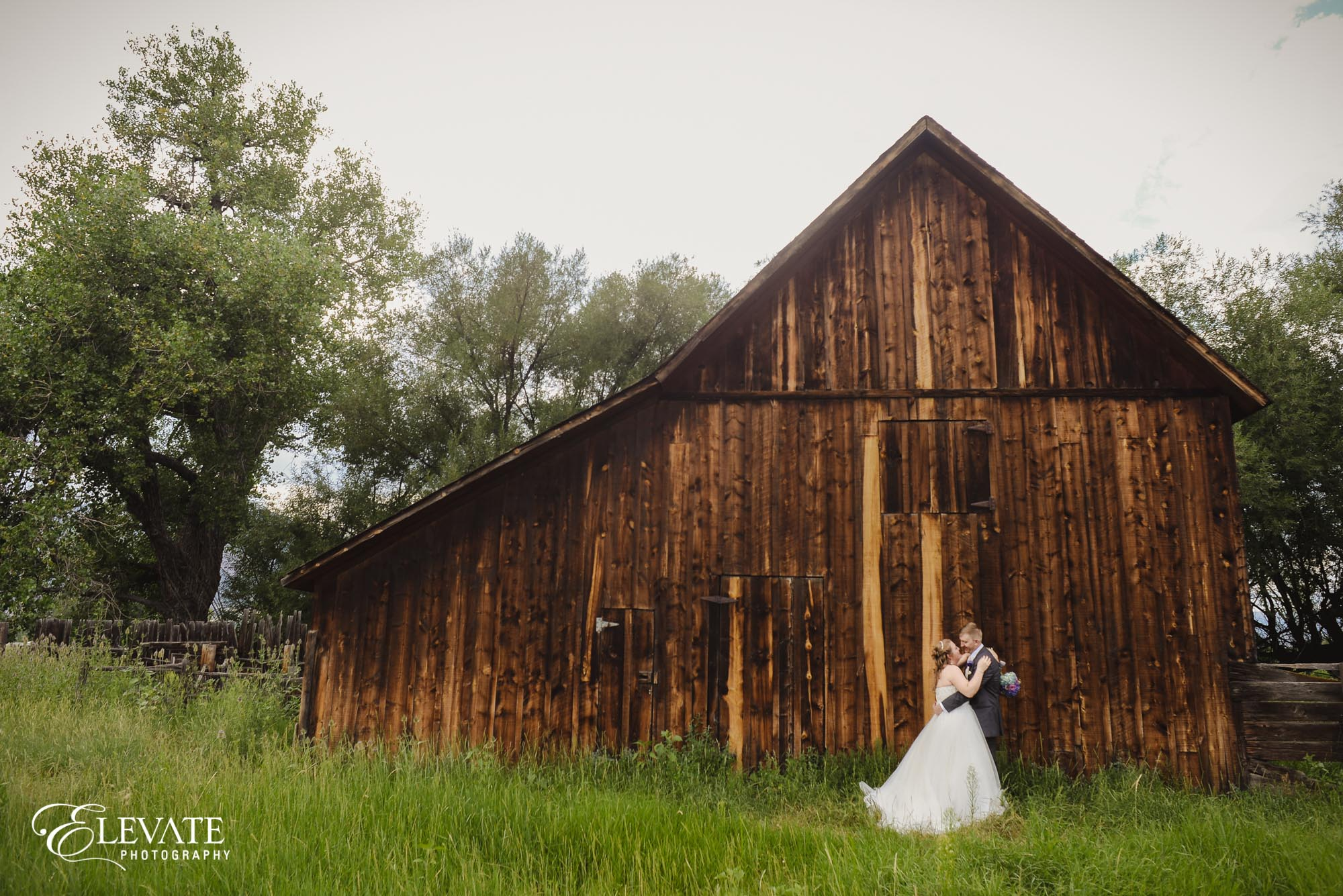 couple by barn