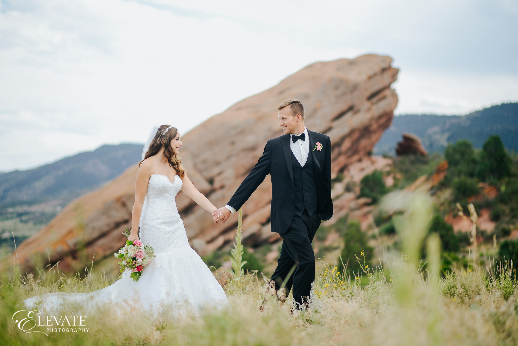 bride groom walking in foothills