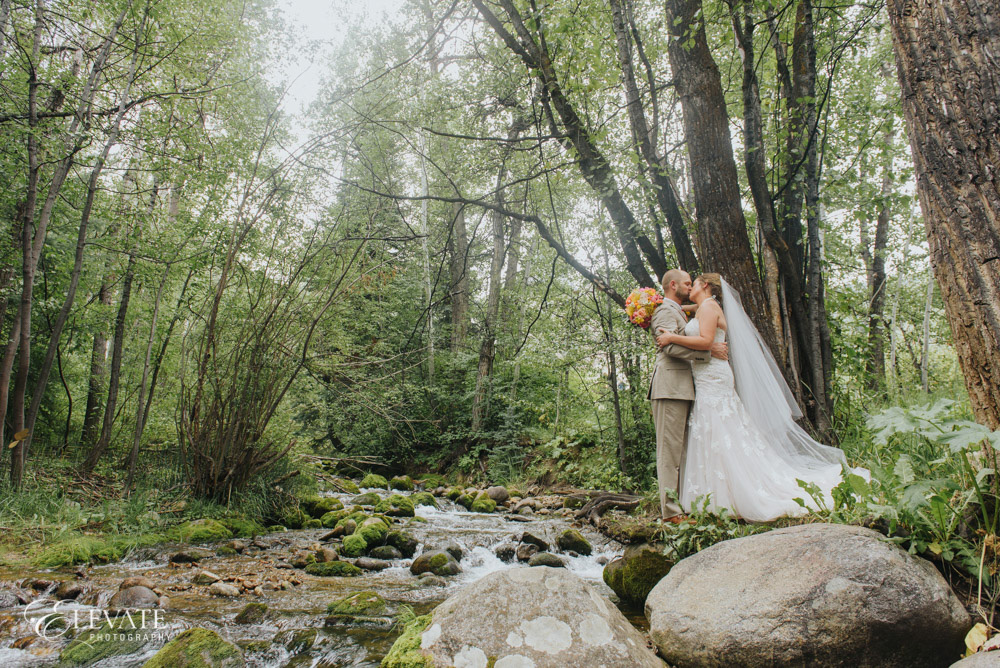 wedding couple by mountain river