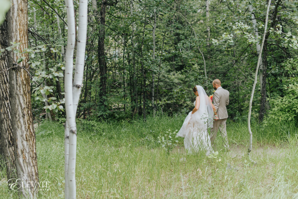 couple in mountain grasses of Beaver Creek