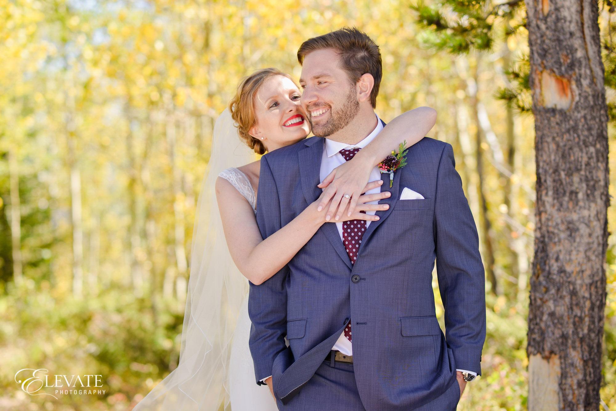 groom blue suit maroon tie bride red lipstick
