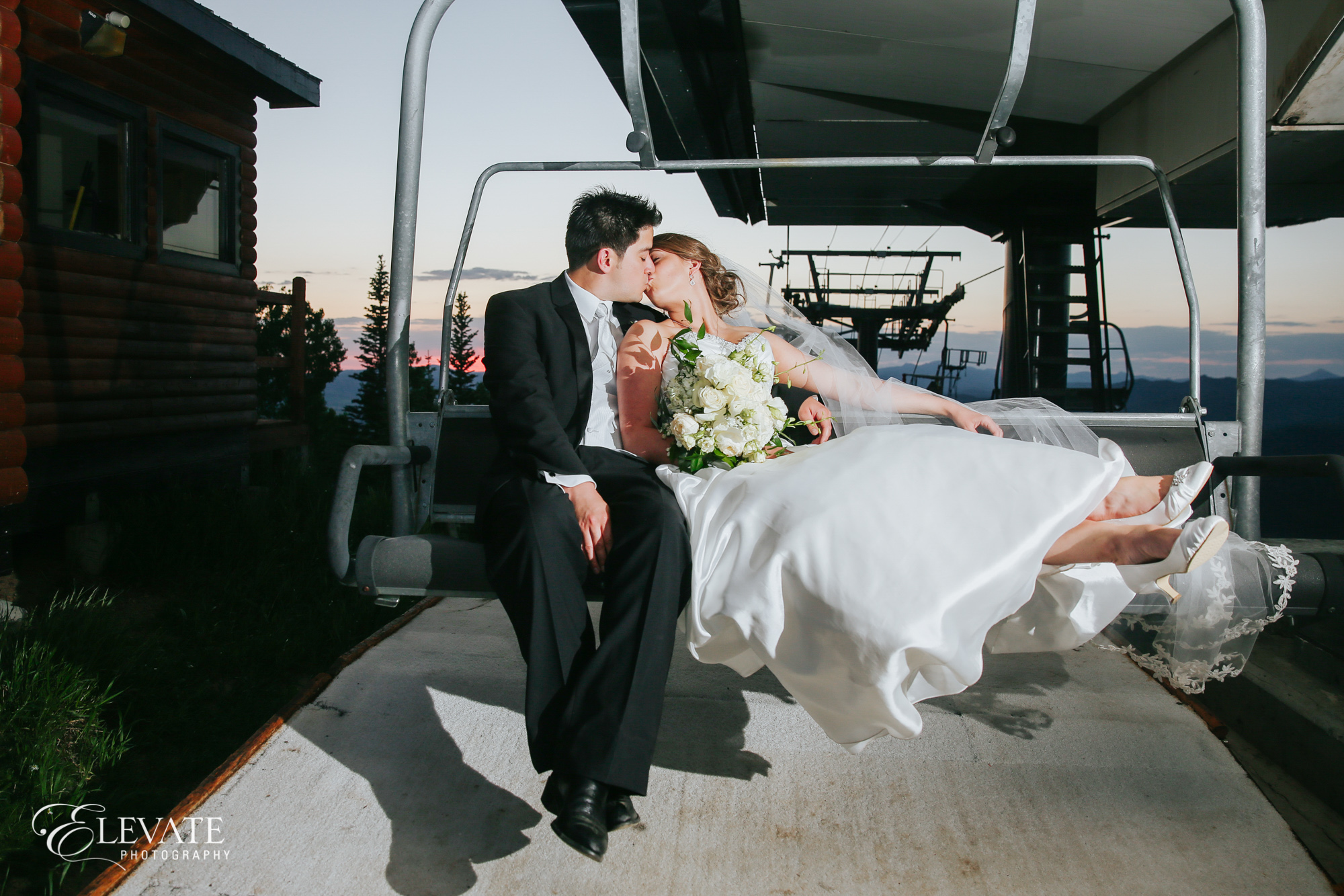 wedding couple kissing on ski lift at Steamboat Springs
