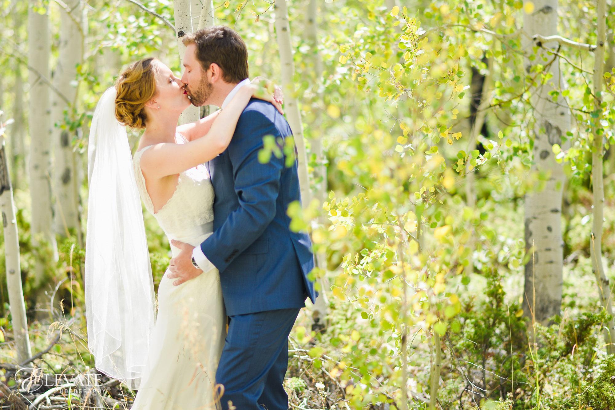wedding couple kiss woods fall
