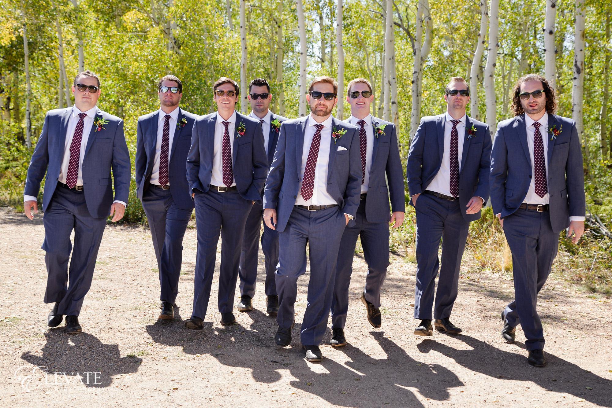 groomsmen sunglasses blue suits