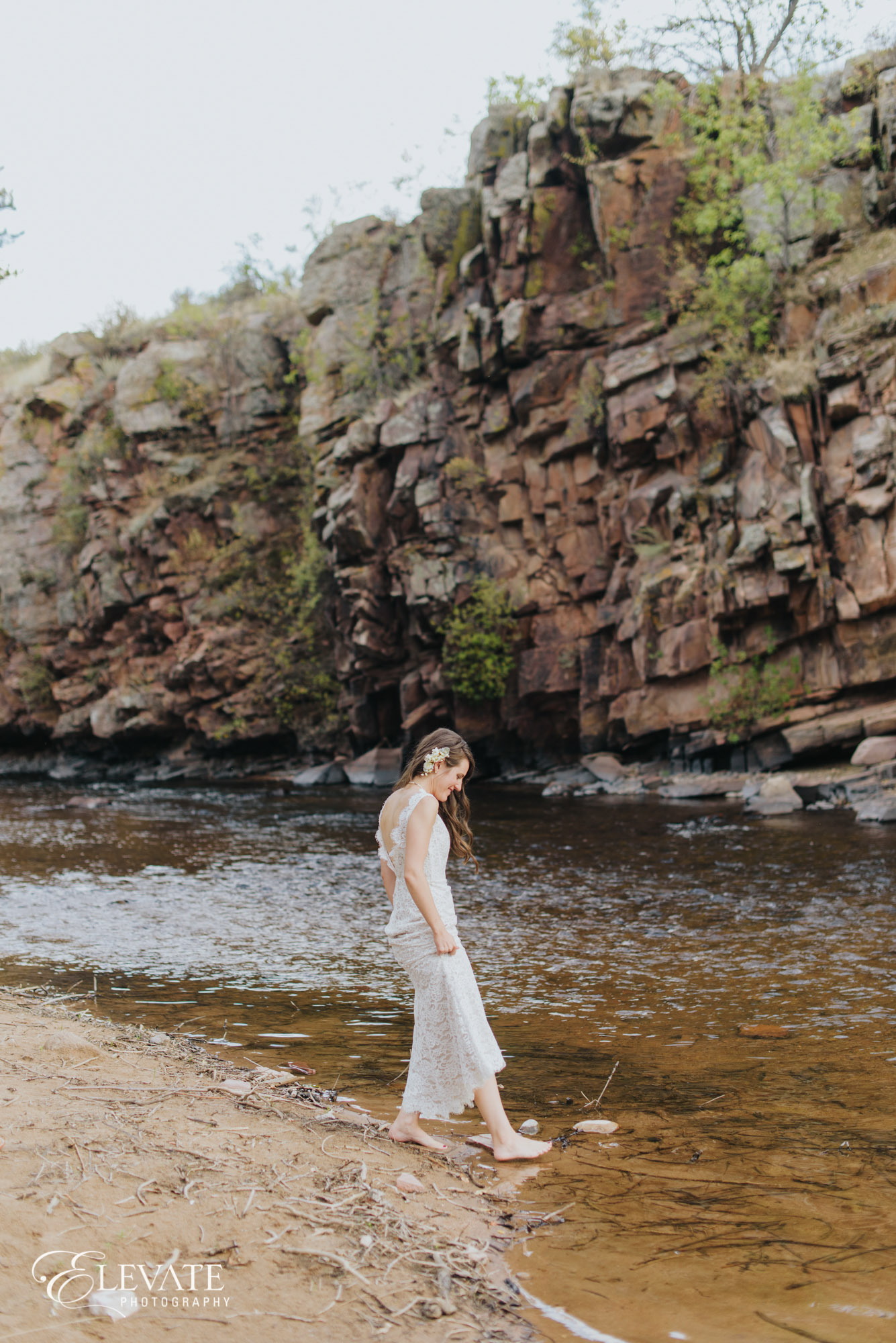 bride in river with dress