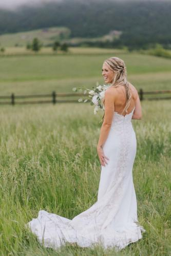 bride in dress in field