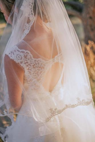 detail of wedding dress and veil