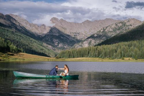 couple in boat by mountains