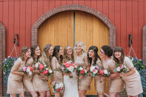 bridesmaids laughing in gold dresses