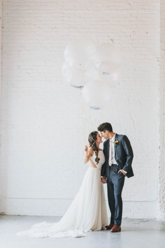 couple with white balloons