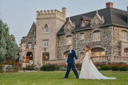 couple with mansion