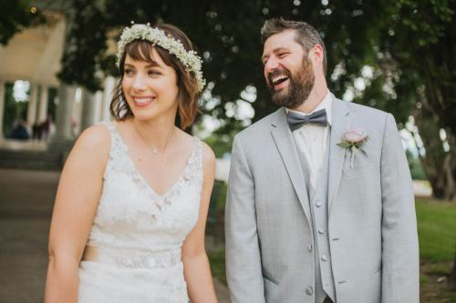 candid bride with flower crown with groom