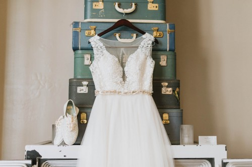 lace dress detail with keds on vintag luggage