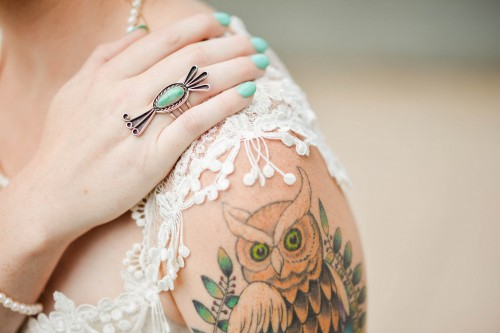 unique ring and tattoo