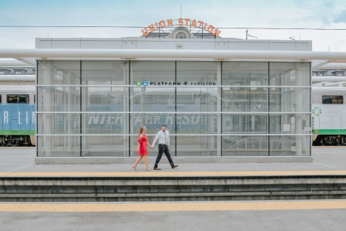 train station engagement red dress