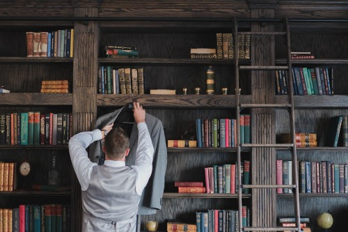 groom dressed in library