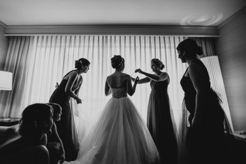bw bride getting dressed