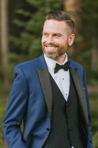 classic groom with beard blue suit